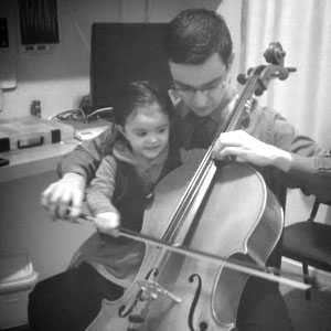 My little daughter helping me to play the cello